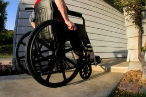 Wheelchair in Front of Adapted Home 1